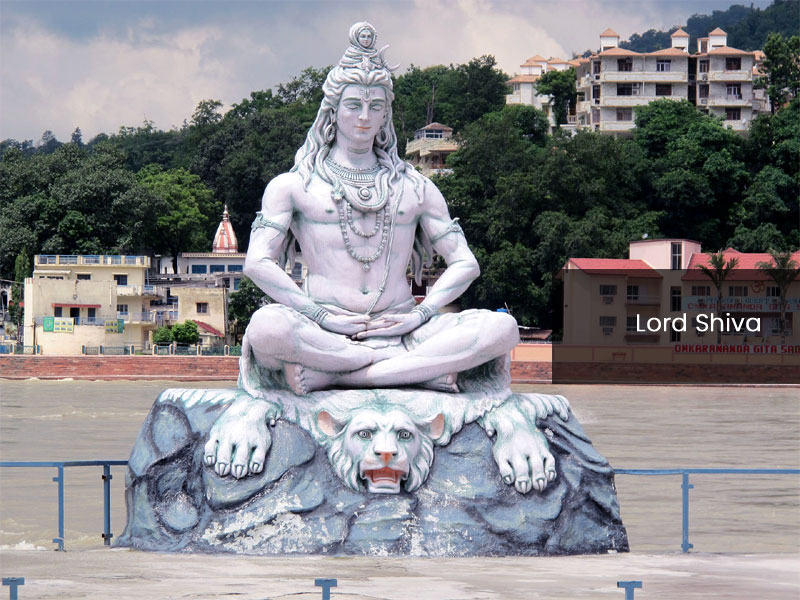 Statue of lord shiva in ganges